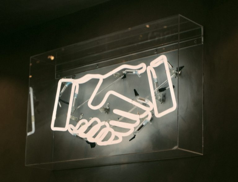 Neon handshake image